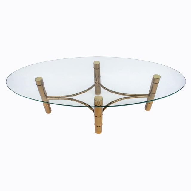 Brass and oval glass faux bamboo vintage coffee table.