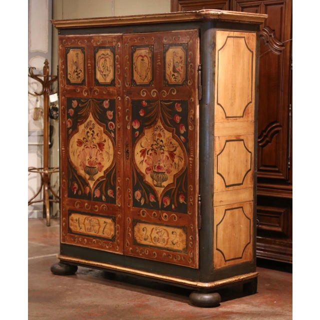 Hide your TV in this large and colorful painted antique armoire. Crafted in the Alsace Lorraine region of France circa...