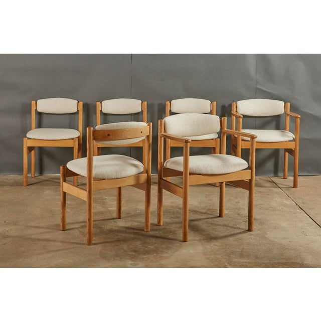 Unusual oak dining chairs made in Denmark by FDB MOBLER, designed by Jørgen Bækmark. These chairs have been refinished and...