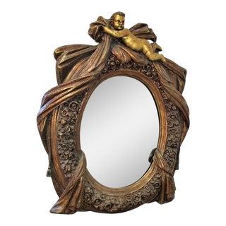 Large Italian Baroque Gilt Cherub or Putti Mirror Frame For Sale