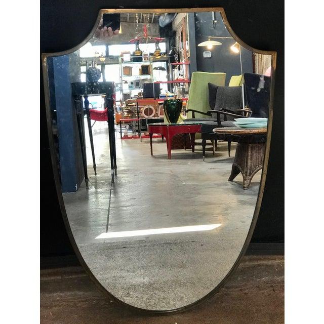 Brass frame Italian shield mirror, 1950s.