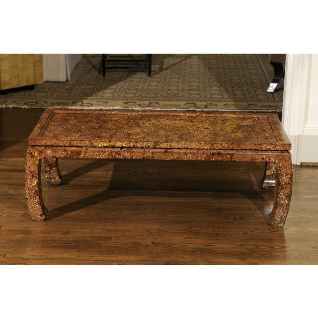 A stunning custom coffee table, circa 1985. Heavy, expertly crafted Mahogany construction with lovely Asian detail. A...