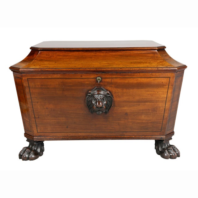 Cellerette with rectangular hinged top with chamfered corners, with cove edge over a conforming case with ebonized...