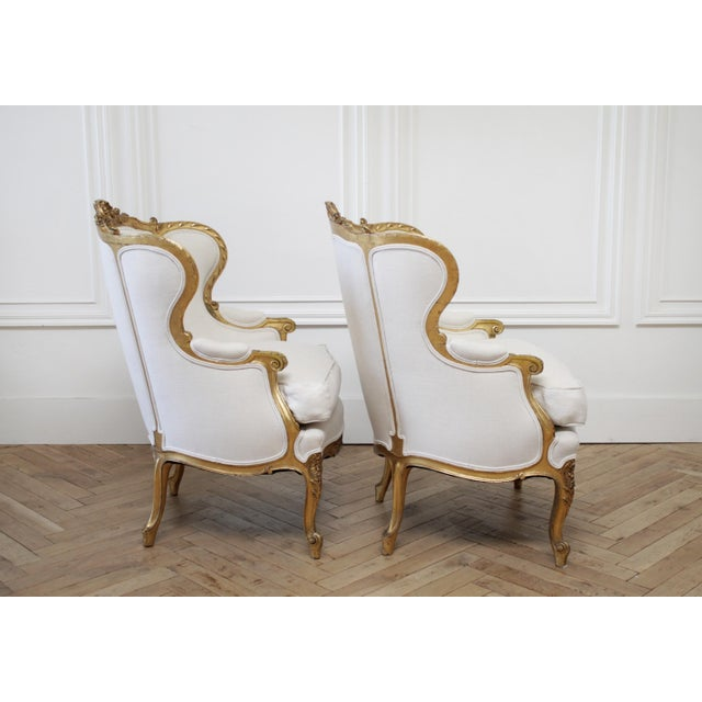 Pair of Antique Giltwood Linen Upholstered Bergère Chairs For Sale - Image 4 of 13