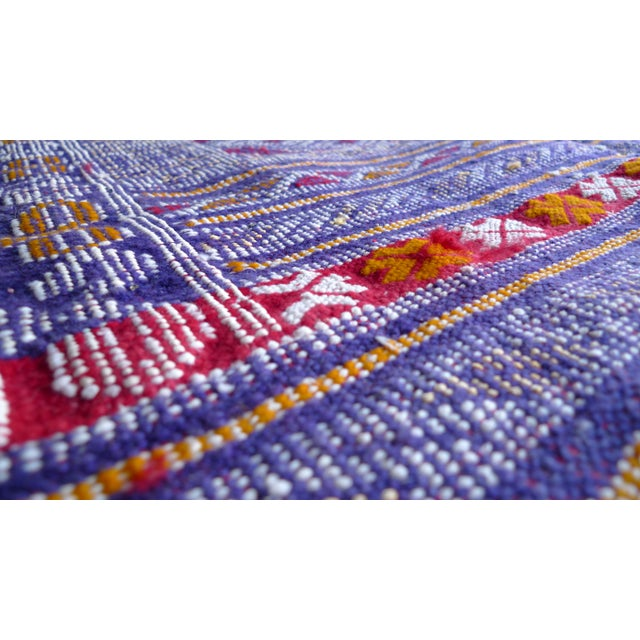 Vibrant and luxurious, this hand woven Moroccan rug is richly colored with interesting textures. Moroccan rugs are...