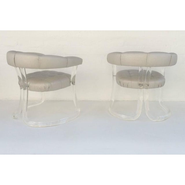 1970s sculpted acrylic armchairs, newly professionally polished and reupholstered in a natural linen with a metallic...