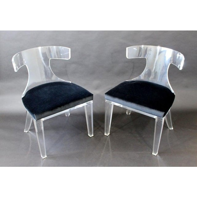 For your consideration is a stunning pair of curved Lucite side chairs, with velvet seats, by Safavieh Couture. In...