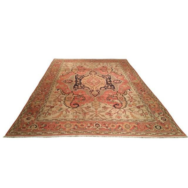 Infuse a touch of beauty to high-traffic areas of your home with this durable Traditional Soumak rug in colors of salmon,...