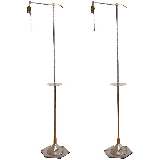 An Art Deco pair of nickel-plated bronze floor or bridge lamps with hexagonal base by Walter Kantack. The lamps are ribbed...