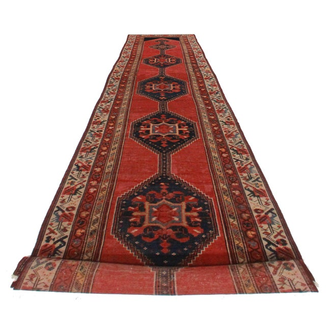 Offered is a beautiful antique Persian Malayer runner rug. This beauty features a handmade wool pile with tones of red,...