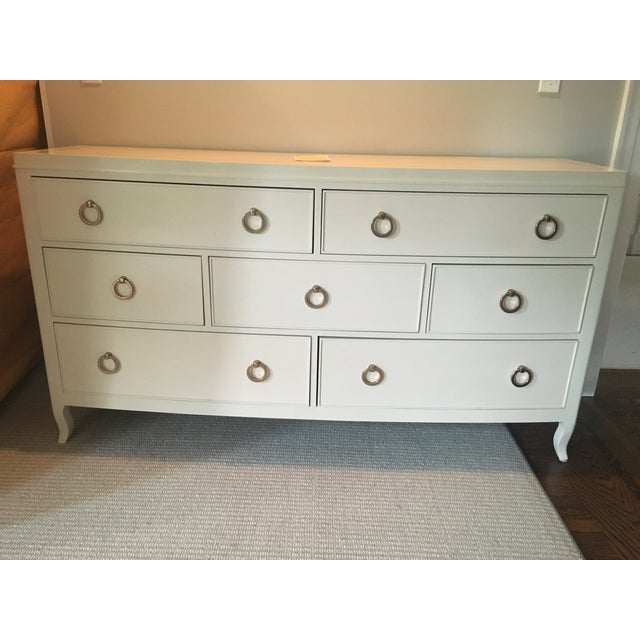 Virtually new 7-drawer dresser. Clients changed their minds. Quality furniture with maple veneers, alabaster finish,...