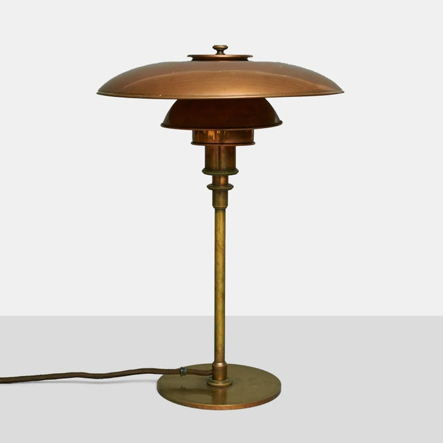 Poul Henningsen, PH 3/2 Table Lamp, Early Model A table lamp by Poul Henningsen with browned brass frame, socket cover and...