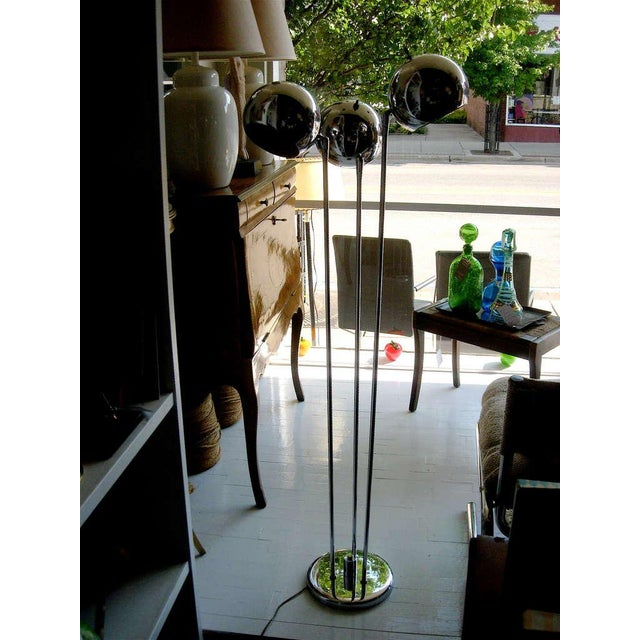 Very chic mid century three light floor lamp in polished chrome.