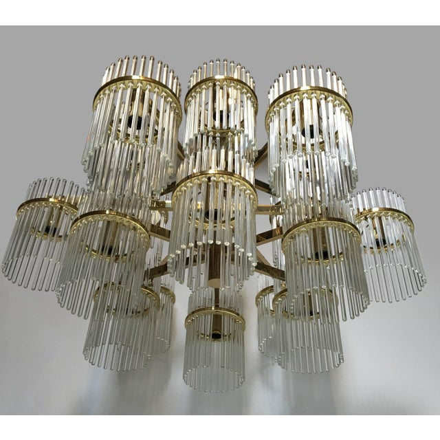 A large 18 arm brass and glass chandelier by Gaetano Sciolari (with label), Italian 1970's