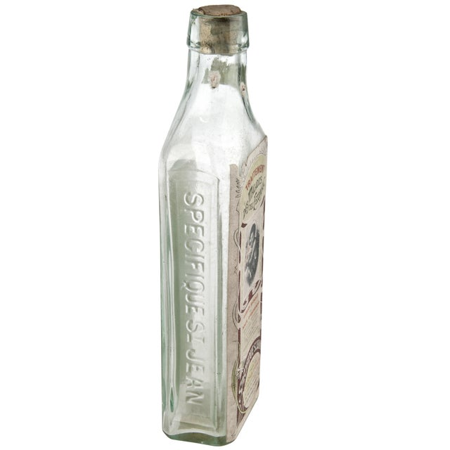 Vintage stomach malady treatment bottle from France. Original label and cork. Some original sediment in bottom.