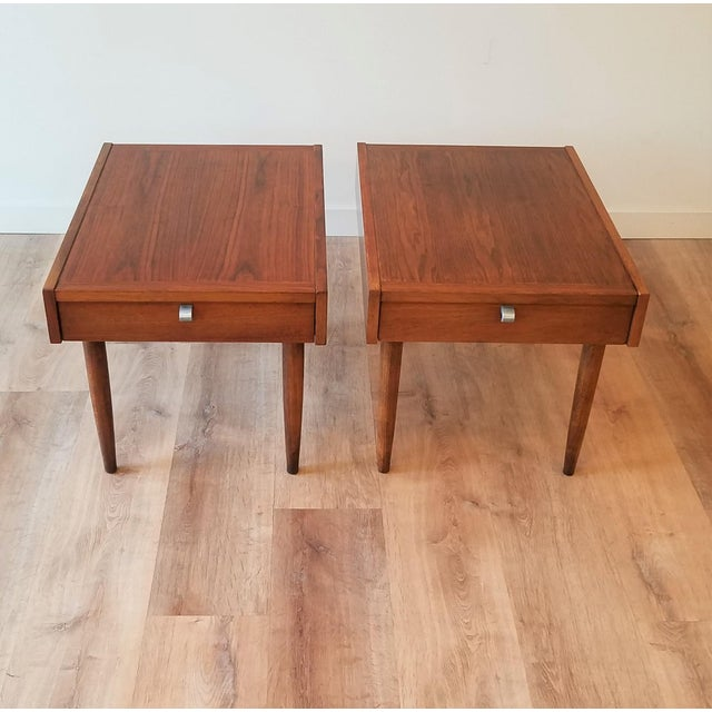 This pair of 1-drawer end tables designed by Merton Gershun for American of Martinsville can be utilized as either a side...