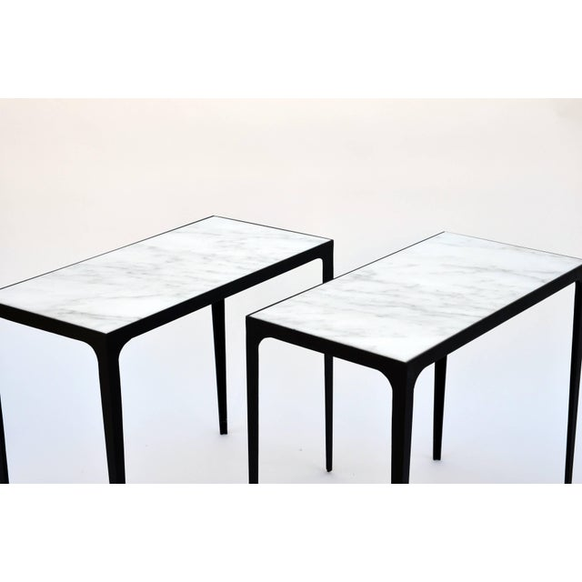 Pair 'Esquisse' of wrought iron and honed marble side tables in the style of Jean-Michel Frank.