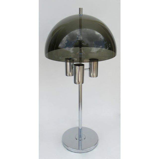 C.1970s; Mid-Century Modernist, lamp attributed to Lightolier This smoked lucite, in a mushroom or space-age shaped domed...