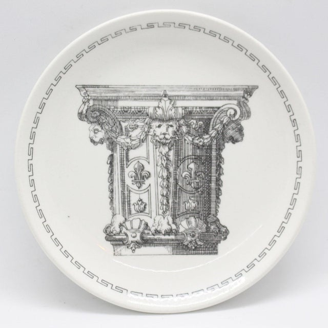 Set of four collectible porcelain dishes circa 1950 featuring neo-classical architectural column capitols from...