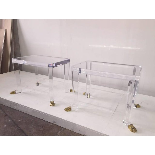This unique design of 2 inch thick acrylic top and elegant tapered legs, finished with vintage bronze lion claw feet.