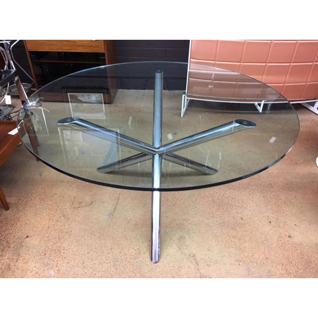 JAX dining table with heavy glass in the style of Milo Baughman. Truly nice table with an artistic JAX presentation.