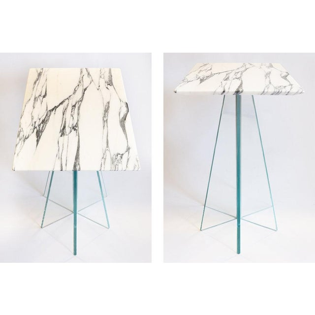 Six tapered, radial glass fins create a surprisingly stable base for this marble-topped end table with a reverse-bevel...
