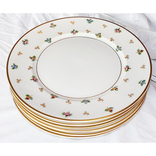 Lighthearted and elegant, a set of six midcentury Molly Pitcher floral and 23k gold decorated dinner chargers by U.S made...