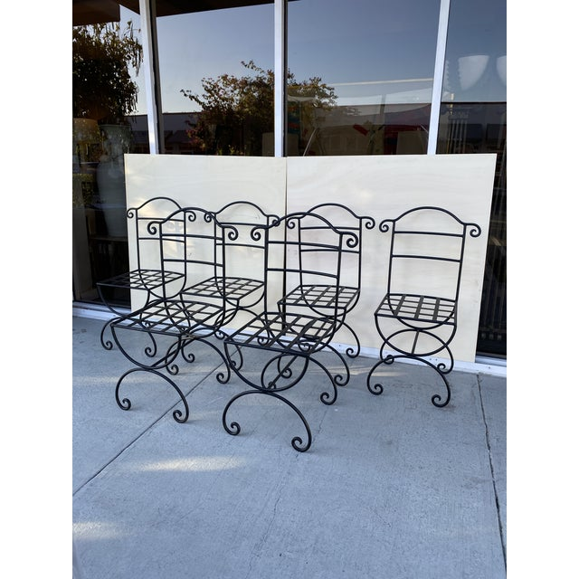This is incredible set of six (6) patio chairs in wrought Iron with Oriental influence chairs are very strong and they...