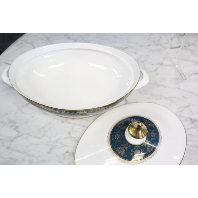 Royal Doulton English fine bone China in Carlyle. Beautiful white porcelain with turquoise and gold floral accents....