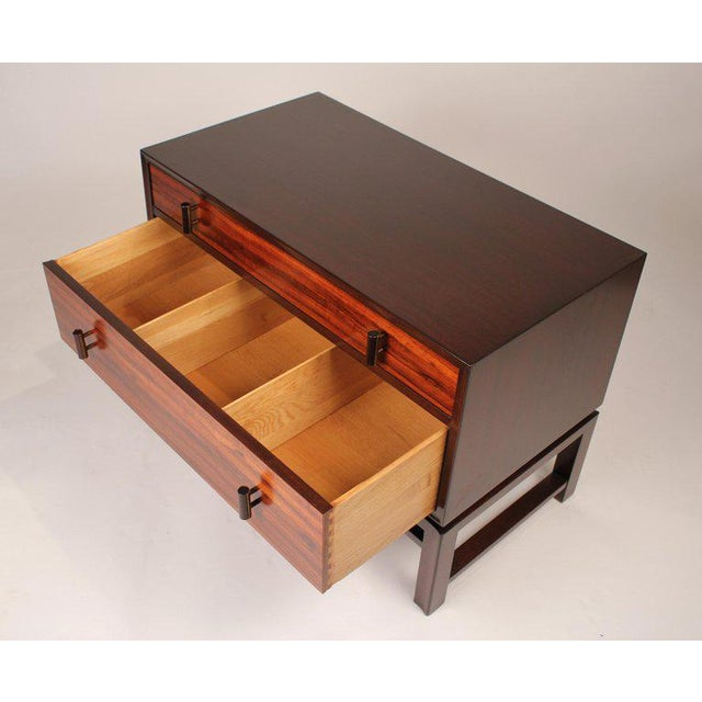 Nightstands designed by Edward Wormley for Dunbar. Constructed with rosewood, mahogany with ebony hardware encased in...
