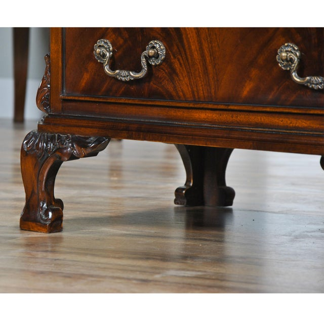 A fine quality Chippendale Night Stand featuring hand carved, solid mahogany details as well as dovetailed drawers. Fine...