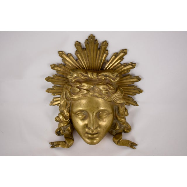 A bronze ormolu fragment representing the Sun King, from the Louis XVI period, the late 1700s, attributed to Pierre-...