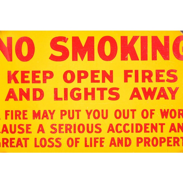 Antique fire danger sign -No Smoking- in yellow porcelain enamel.