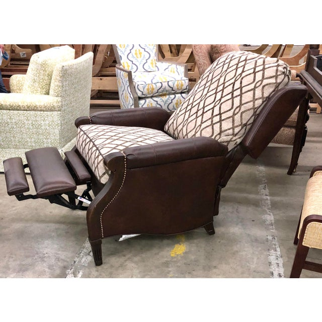 This traditional recliner has so much warmth you will want to stay reclining for a while in the chestnut colored leather...