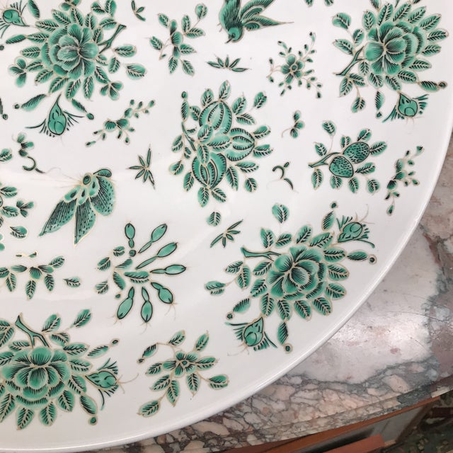 Gorgeous large Chinese charger in green and white of birds and butterflies.