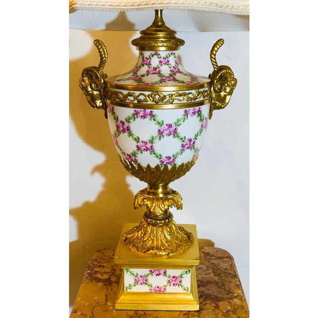 French table lamp trellis floral porcelain urn with bronze horned rams head gilt and bronze mounts. This spectacular urn...