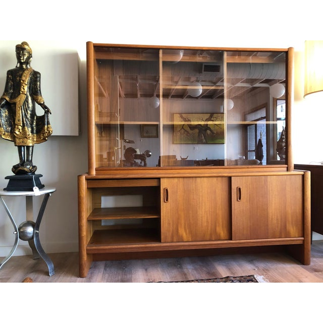 Two-piece Danish modern display with sliding glass doors, recessed lighting, and adjustable shelving. Refreshed finish....