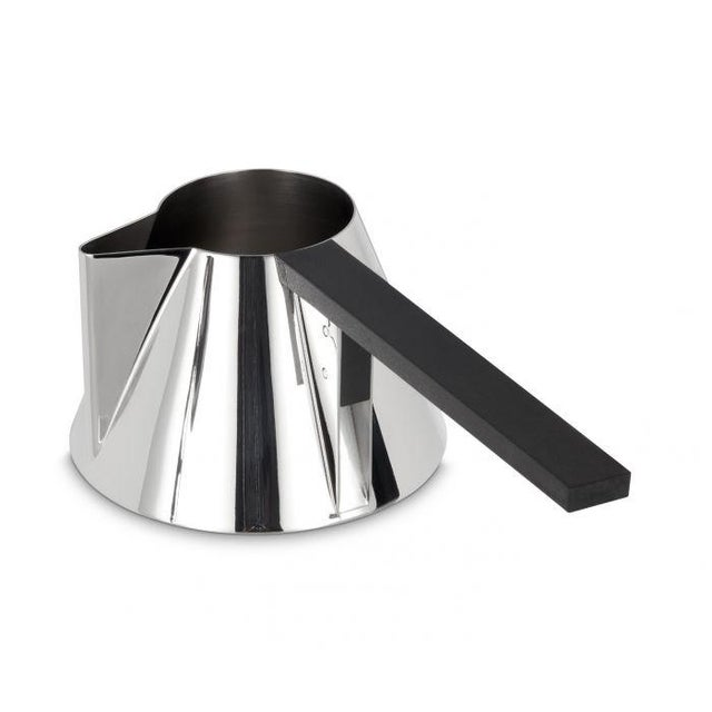 A stainless steel milk pan coated with a stainless steel finish and fitted with a straight handle engineered for even...
