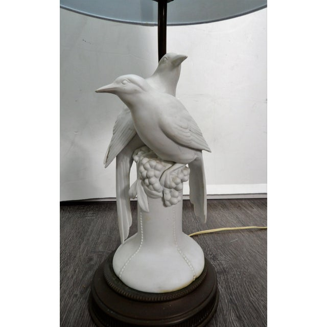Vintage Porcelain lamp featuring a Pair of Doves and grapes on an Ornate Brass Base. The Lamp is delicate not only because...