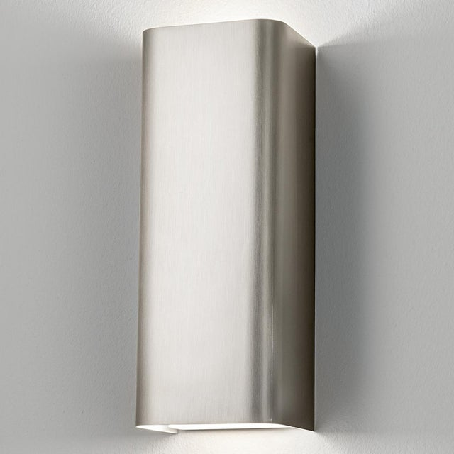 A brushed nickel wall light. Certification: IP 20. Bulb: 2 X GU10 7W LED 2700K
