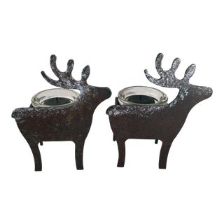 A Pair of Christmas Metal Reindeer Candle Holders For Sale