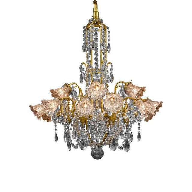 This Baccarat crystal and doré bronze chandelier of monumental size and opulent design is truly a splendid sight to...