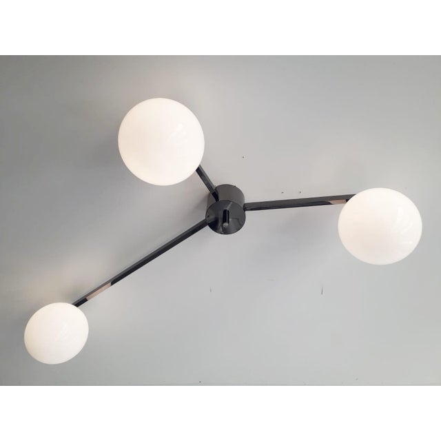 Italian flush mount with glossy white Murano glass globes, mounted on polished black nickel finish frame / Designed by...
