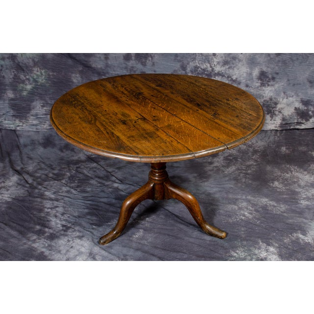 Beautiful Antique Table constructed of English Oak. The top rests on a turned Baluster Column, which is joined to the...