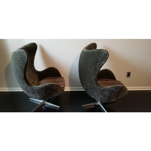 Authentic Arne Jacobsen Egg chairs with gray upholstery.
