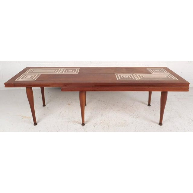 Stunning walnut grain coffee table features a rotating base offering more room for use and convenient storage. Versatile...