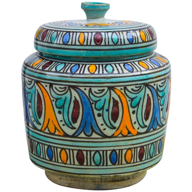 Antique handcrafted and glazed ceramic lidded jar. Features an intricately hand-painted Moorish pattern in a traditional...