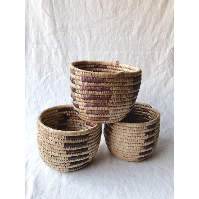Gorgeous and functional handmade vintage grass baskets with lavender and violet detail. They are surprisingly sturdy and...