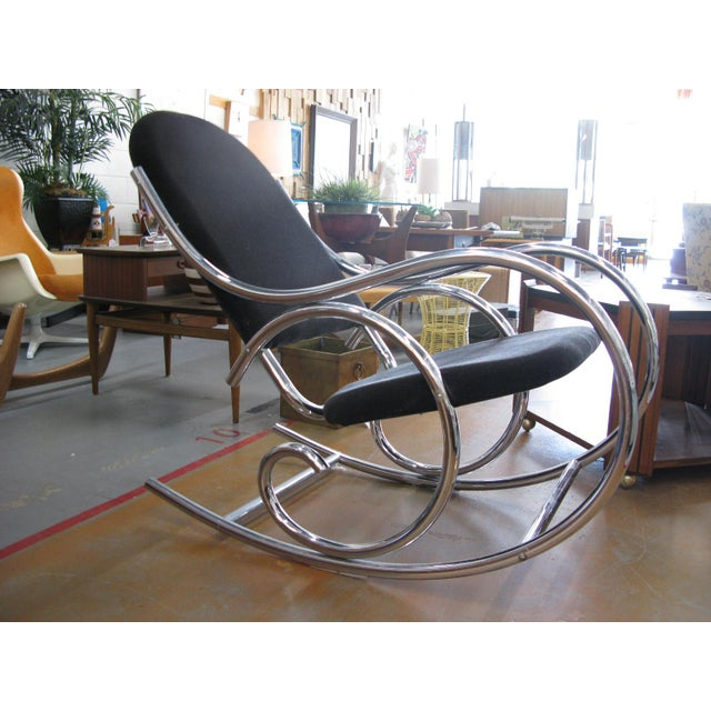 A generously sized upholstered chrome rocker in the style of the iconic bentwood creations of Thonet. Long, sinuous lines...