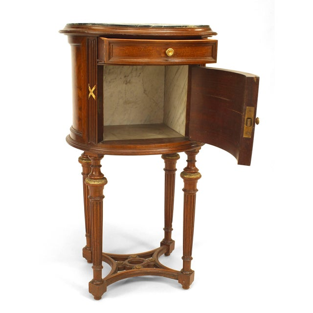 French Louis XVI style (19th century) oval mahogany bedside commode with open stretcher and green marble top.